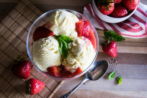 velvety vanilla ice cream with strawberry-basil-rhubarb sauce