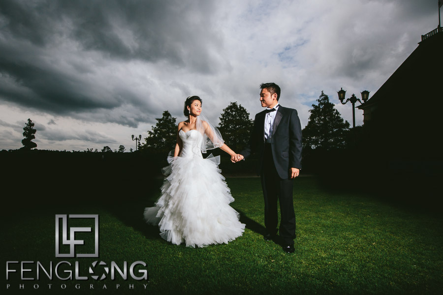 Chinese bride and groom at Chateau Elan under stormy skies