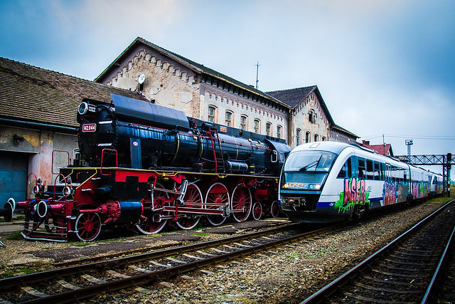 Oradea Train Station, Modern Train with Graffiti and old Steam Powered Locomotive