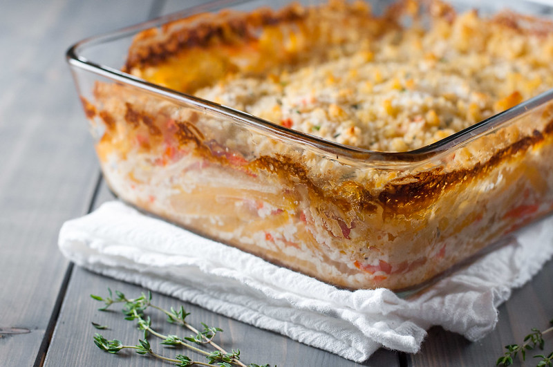 Golden root veg gratin with bright produce and satiny bechamel