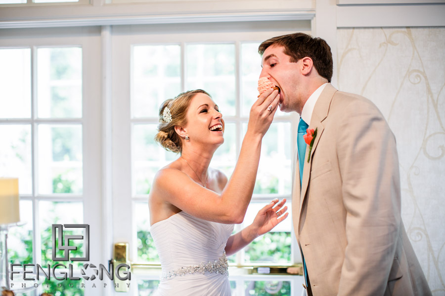 Bride and groom feed each other cupcakes
