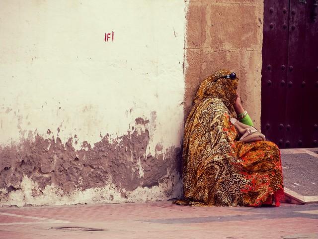Woman in djellaba in Essaouira, Morocco