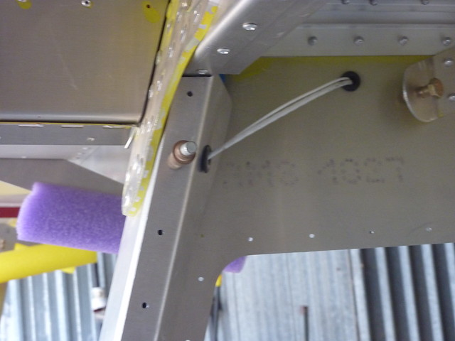 Wing wires going into cover on pax side