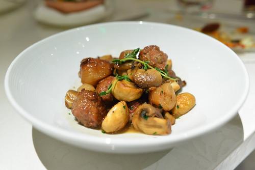 Butifarra Casera Esparracada homemade pork sausage stew with mushrooms and pearl onions
