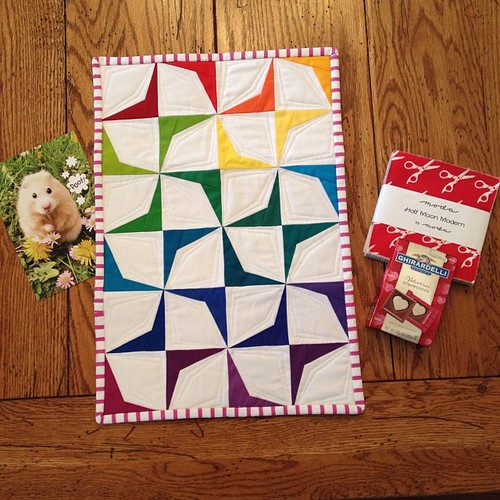 Look at my absolutely awesome mini quilt from @sandra_smith I LOVE it!!! Thanks sooo much!! She also included a half moon modern charm pack! I'm in love!! Oh and one if the funniest cards ever lol. What a great valentines day! Thanks again!! #latebloomers