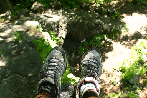 Two different socks - sitting on top of the ruins