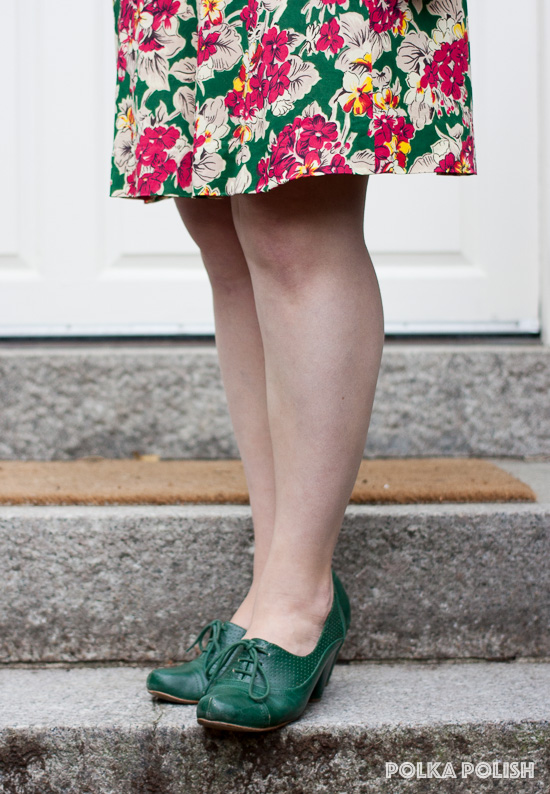 Green lace-up shoes by Chelsea Crew add a practical finishing touch to a vintage floral dress