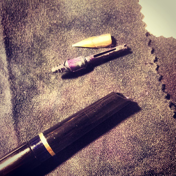 Decided to take apart the nib and feed. Good thing too, that feed needs some cleaning. #Pelikan M30 #fountainpen #repair
