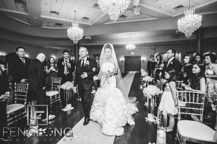 Vietnamese bride and father walk down aisle