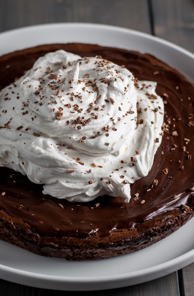 Quick flourless brownie with dark chocolate glaze and whipped coconut cream