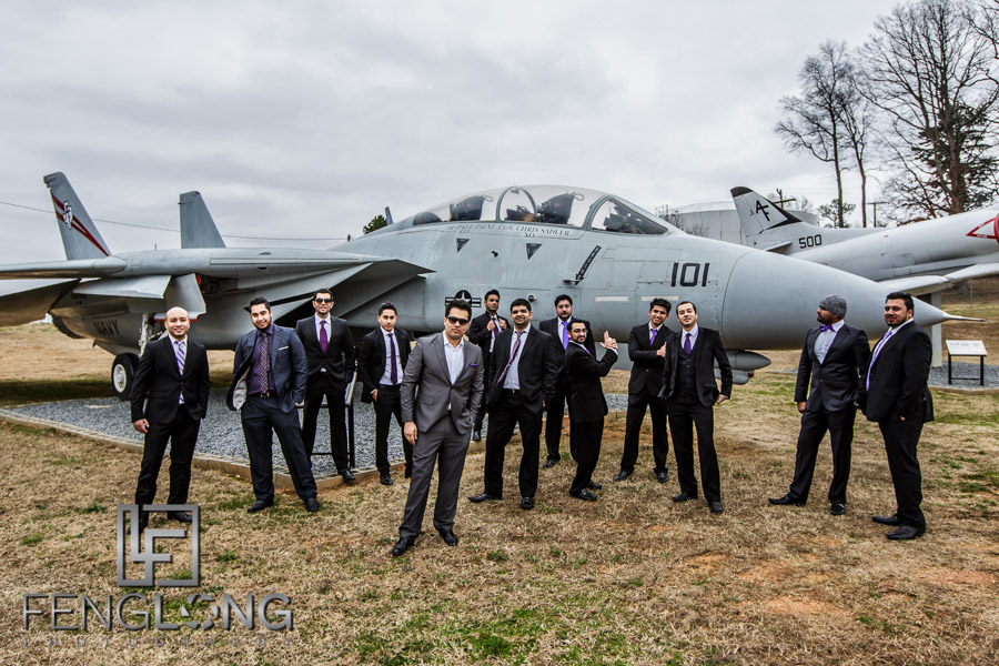 Indian groom and groomsmen in front of airplane during pre-wedding shoot at airport