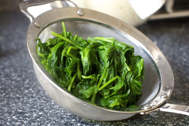 wilted spinach, to drain and squeeze