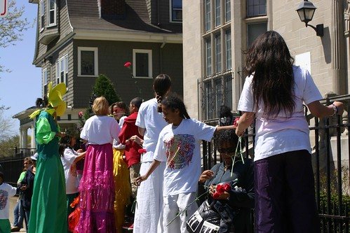 Kids on stilts wait for the parade