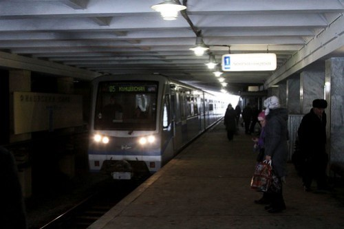 Train arrives into the surface level station of Филёвский парк (Filyovsky Park)