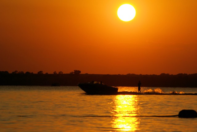 Skier and Setting Sun Over Canton Lake, Oklahoma, August 29, 2009