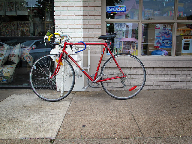 Red Bike In Front Of Froggies