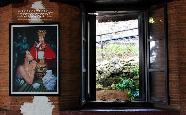 Juana praying to sto nino painting fort san pedro