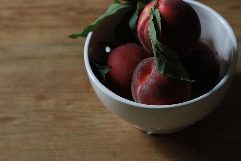 peaches in a white bowl