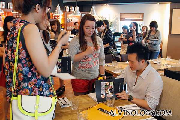 Nicholas signing his books for fans at Platypus Kitchen