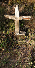 an abandoned cross and neglected grave in Ostional, Costa Rica