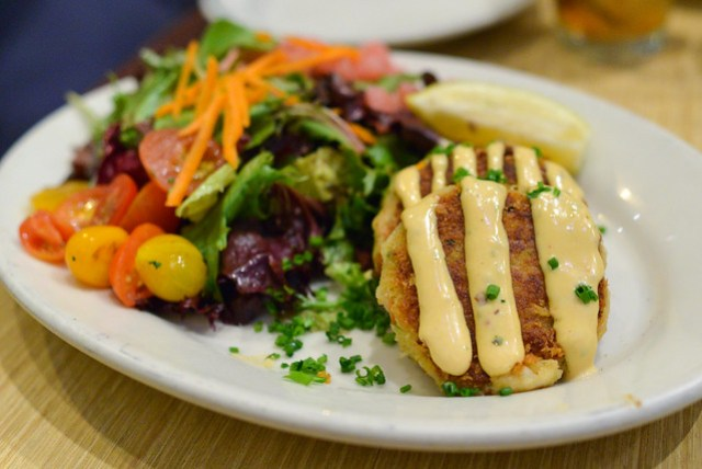 Crab Cakes crab meat cakes topped with spicy chipotle sauce & a side salad