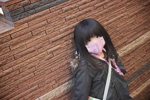 SAKURAKO wears a protective mask.