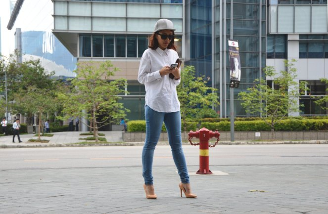 Oversized white blouse, grey leather cap, fossil leather wallet, nude heels