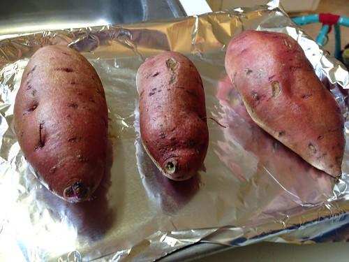 sweet potatoes scrubbed, pierced, and ready to become baked sweet potatoes
