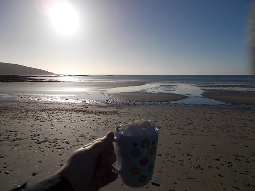 hot choc with squirty cream at the beach