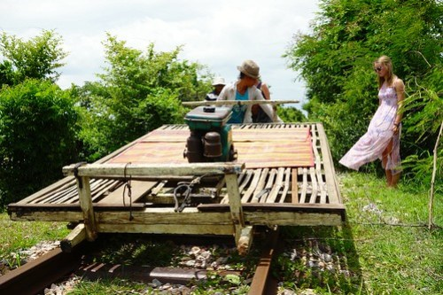Passing trains, lifting the platform - Bamboo Train in Battambang, Cambodia
