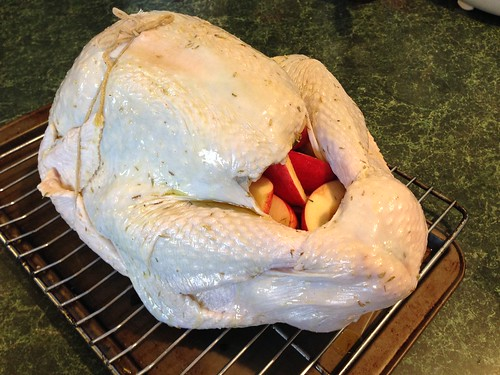 Turkey wtuffed with apples, carrot, onion and rosemary before going in the smoker