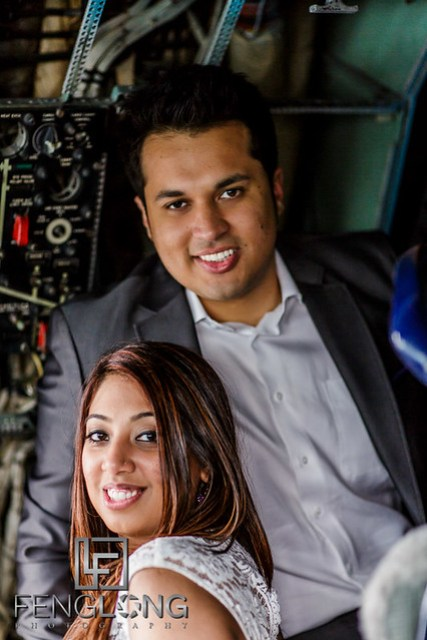 Indian Ismaili bride and groom in airplane cockpit for unique pre-wedding photo shoot