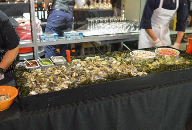 Seasonal Oysters with Trio of Granitas cocktail with shaved horseradish, smoky chipotle vinegar, cucumber serrano tomatillo