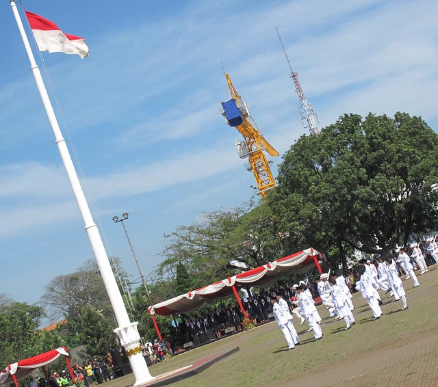 the flag is raised by Paskibraka