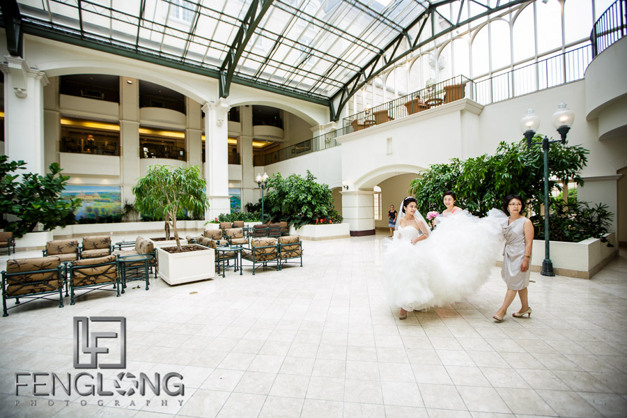 Bride and mother walk through lobby