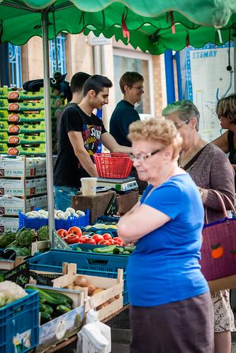 Stenay, France, Friday street market.  Shopping for produce.