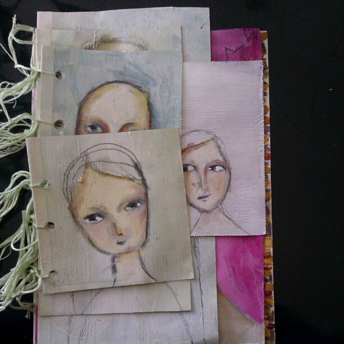 Playing with mixed media faces in one of my junk postcard books.