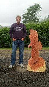 spread eagle chainsaw carving