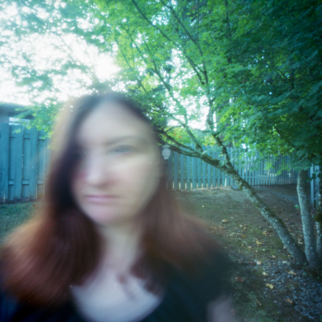 Self portrait in the back yard, under the tree.