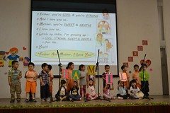 kg 2 students performs songs and poem on the stage