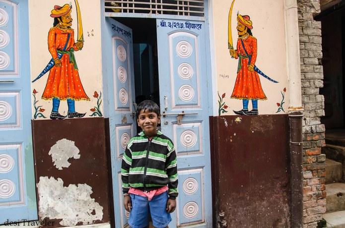 Street art Varanasi boy warrior