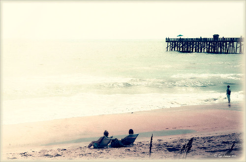 Image of people relaxing on Flagler Beach with a retro look