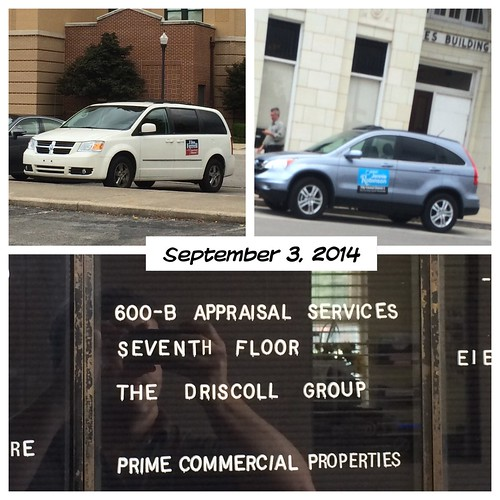 Ferrell's and Robinson's cars outside Old Times Building and Driscoll's office 9/3/14.