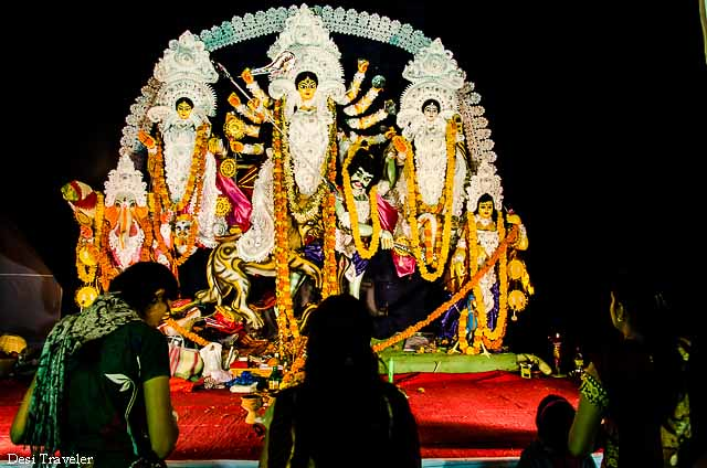 devottes in front of durga maa