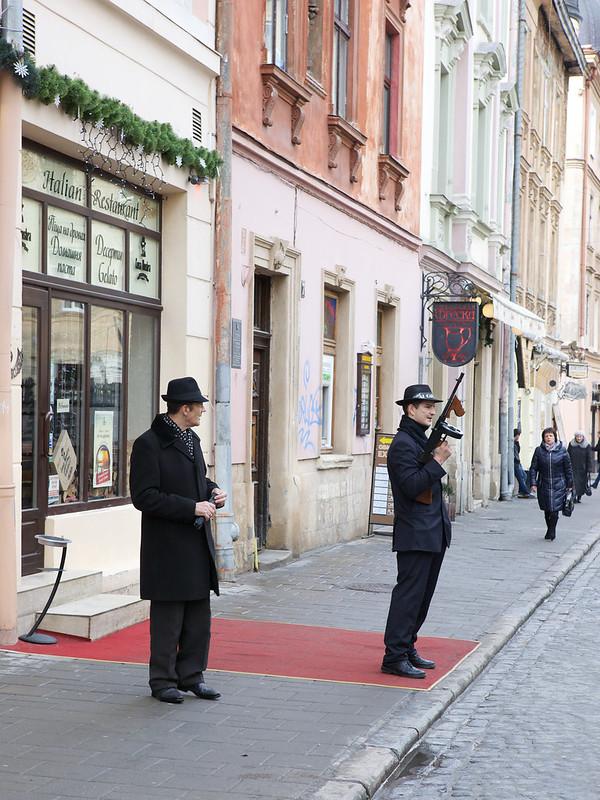 """Men in black"". People on a street, Lviv, Ukraine"