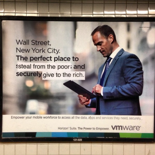 Wall Street New York City. The perfect place to [steal from the poor] and securely [give to the rich.] (Lorimer St; Manhattan bound L)