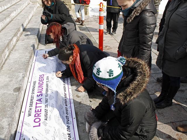 Loretta Saunders banner signing