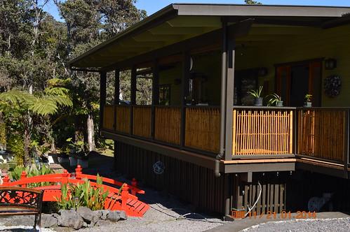 House of Bonsai, lanai with bamboo railing overlooking koi pond