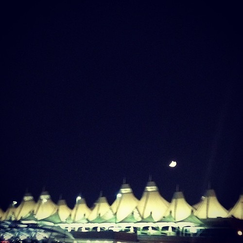 Not a UFO just the moon over DIA #denver by @MySoDotCom