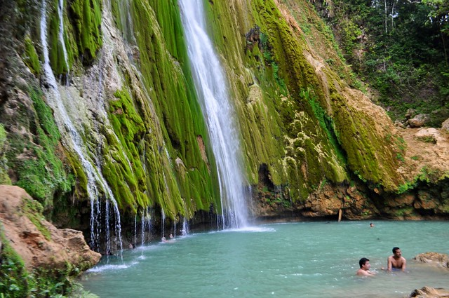 Swimmers Enjoy the Base of El Limón Waterfall in the Dominican Republic